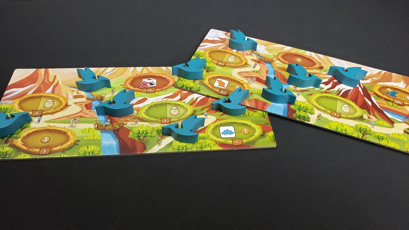 Draftosaurus: Aerial Show comes with 2 boards and 10 pterodactyl meeples.